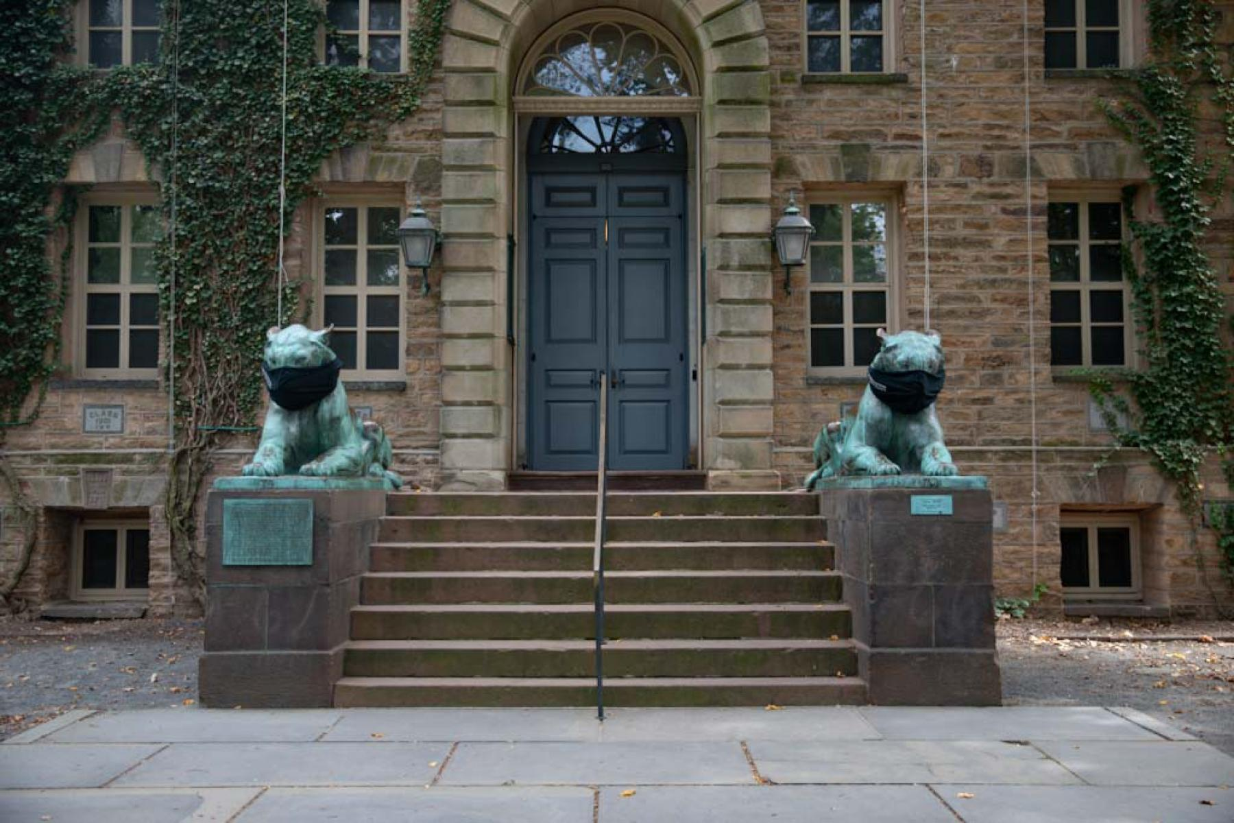 Tiger statues with masks outside Nassau Hall